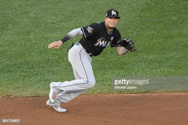Miguel Rojas of the Miami Marlins prepares to field a ground ball during a baseball game against the Washington Nationals at Nationals Park on August...