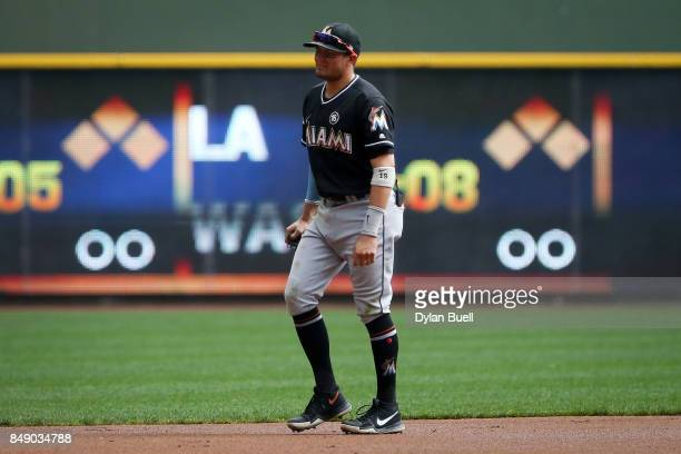 Miguel Rojas of the Miami Marlins reacts after being injured in the second inning against the Milwaukee Brewers at Miller Park on September 17 2017...