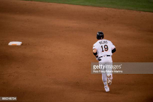 Miguel Rojas of the Miami Marlins rounds the bases on his home run during the eighth inning against the New York Mets at Marlins Park on September 20...