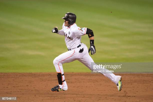 Miguel Rojas of the Miami Marlins runs to third base during a MLB game against the Washington Nationals at Marlins Park on August 1 2017 in Miami...