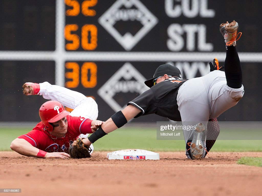 Miguel Rojas #19 of the Miami Marlins tags out <a gi-track='captionPersonalityLinkClicked' href=/galleries/search?phrase=David+Lough&family=editorial&specificpeople=6780100 ng-click='$event.stopPropagation()'>David Lough</a> #3 of the Philadelphia Phillies trying to steal second base in the bottom of the first inning at Citizens Bank Park on May 18, 2016 in Philadelphia, Pennsylvania.