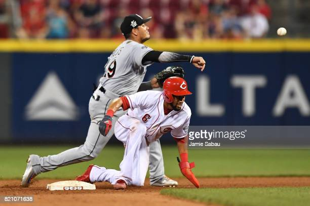 Miguel Rojas of the Miami Marlins throws to first base to complete a double play after forcing out Billy Hamilton of the Cincinnati Reds in the...