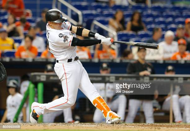 Miguel Rojas of the Miami Marlins watches his home run against the New York Mets at Marlins Park on September 20 2017 in Miami Florida