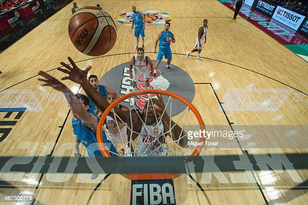 Miguel Ruiz of Venezuela fights for a rebound during a second stage match between Venezuela and Uruguay as part of the 2015 FIBA Americas...