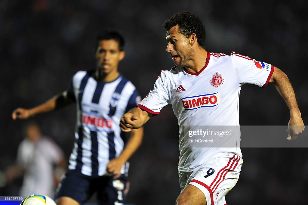 Miguel Sabah fight for the ball during the match between Monterrey and Chivas as part of the Clausura 2013 on February 9, 2013 in Monterrey, Mexico.