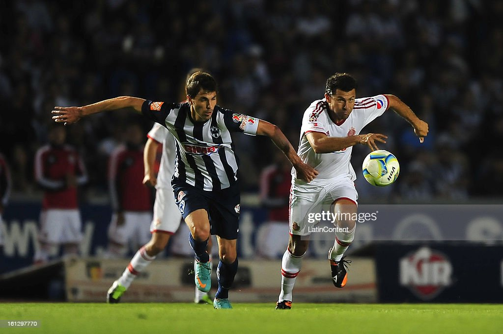 Miguel Sabah fights for the ball with Jose Basanta during the match between Monterrey and Chivas as part of the Clausura 2013 on February 9, 2013 in Monterrey, Mexico.