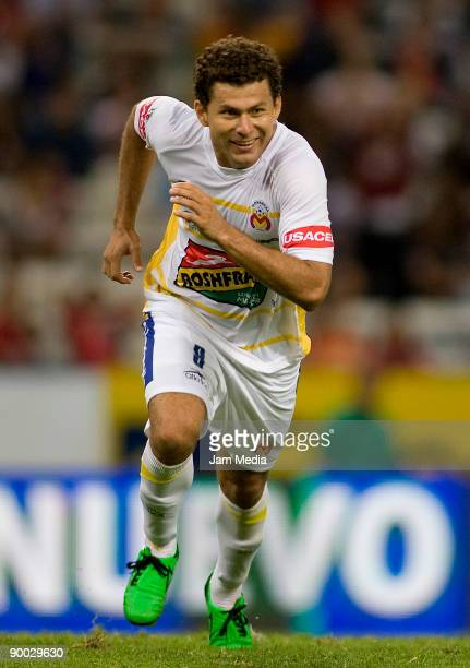 Miguel Sabah of Monarcas Morelia celebrates a goal against Atlas during their match for the 2009 Opening tournament the closing stage of the Mexican...