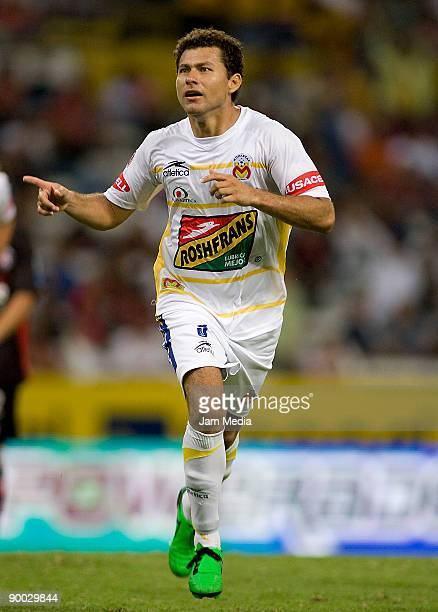 Miguel Sabah of Monarcas Morelia celebrates a goal during the match against Atlas for the 2009 Opening tournament the closing stage of the Mexican...