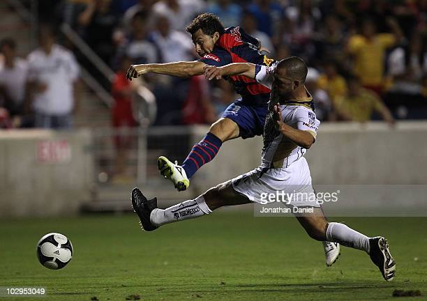 Miguel Sabah of Monarcas Morelia fires a shot past Fernando Espinosa of Pumas UNAM during a SuperLiga 2010 match at Toyota Park on July 17 2010 in...