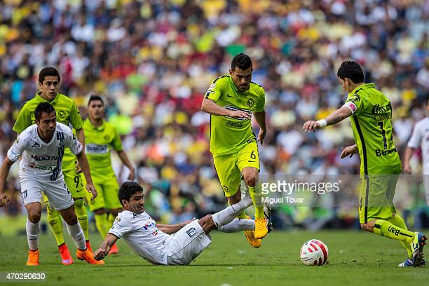 Miguel Samudio of America drives the ball as Antonio Naelson of Queretaro slides during a match between America and Queretaro as part of 14th round...