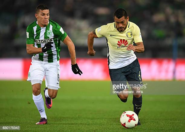 Miguel Samudio of Club America and Mateus Uribe Villa of Atletico Nacional in action during the FIFA Club World Cup 3rd Place match between Club...