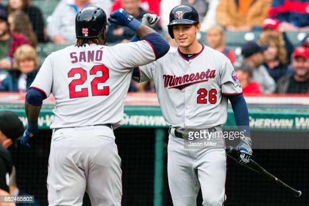 Miguel Sano celebrates with Max Kepler of the Minnesota Twins after San hit a solo home run during the first inning against the Cleveland Indians at...