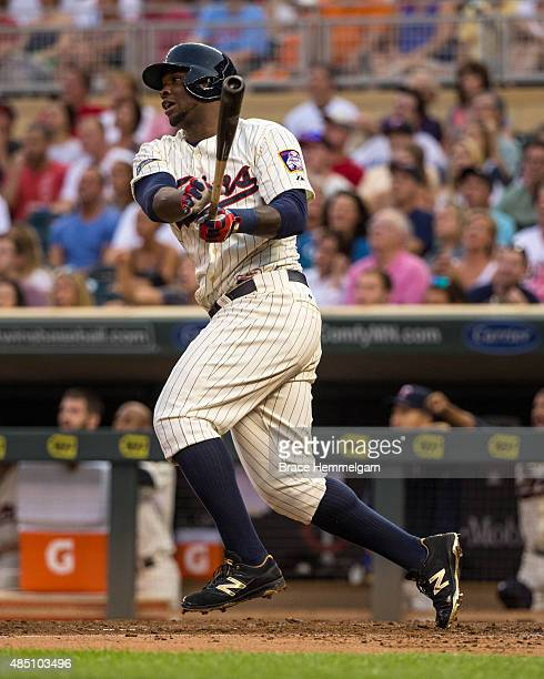 Miguel Sano of the Minnesota Twins bats and hits a home run against the Texas Rangers on August 12 2015 at Target Field in Minneapolis Minnesota The...