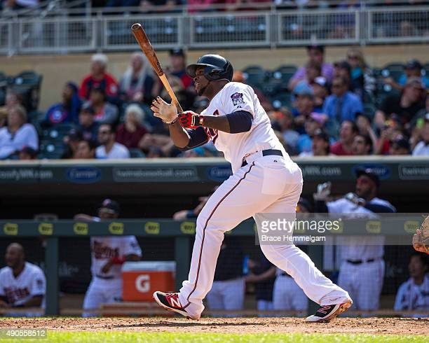 Miguel Sano of the Minnesota Twins bats and hits a home run in the first game of a doubleheader against the Los Angeles Angels on September 19 2015...