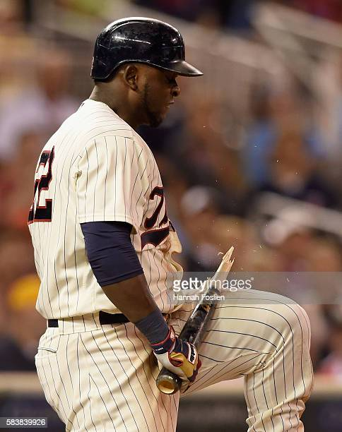 Miguel Sano of the Minnesota Twins breaks his bat after striking out in an at bat against the Atlanta Braves during the eighth inning of the game on...