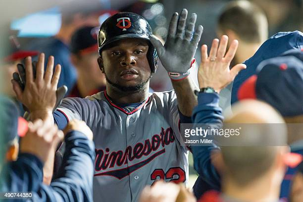 Miguel Sano of the Minnesota Twins celebrates after hitting a solo home run during the eighth inning against the Cleveland Indians at Progressive...