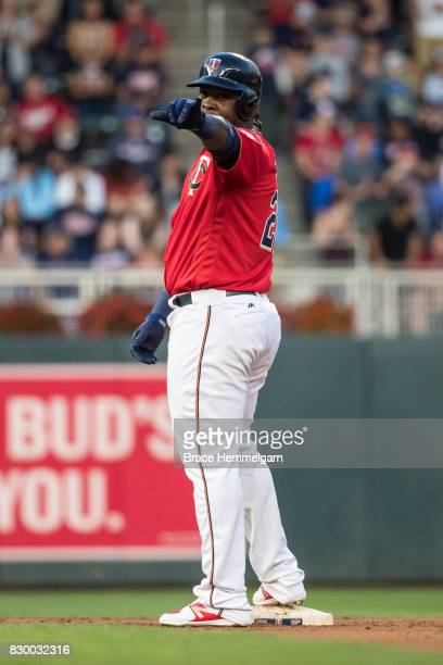 Miguel Sano of the Minnesota Twins celebrates against the Texas Rangers on August 4 2017 at Target Field in Minneapolis Minnesota The Twins defeated...