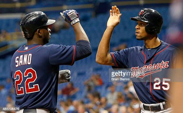 Miguel Sano of the Minnesota Twins celebrates at the plate with teammate Byron Buxton following his threerun home run during the first inning of a...