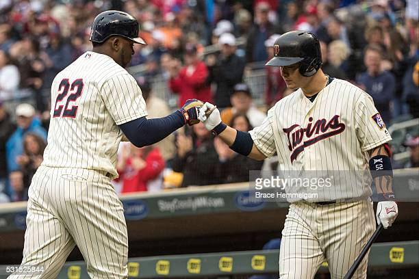 Miguel Sano of the Minnesota Twins celebrates with Byung Ho Park after hitting a home run against the Baltimore Orioles on May 11 2016 at Target...