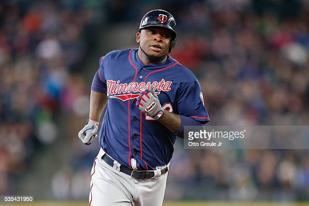 Miguel Sano of the Minnesota Twins circles the bases after hitting a solo home run against the Seattle Mariners in the fourth inning at Safeco Field...