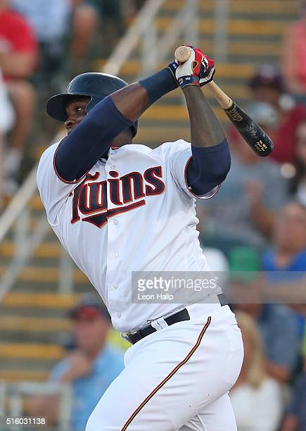 Miguel Sano of the Minnesota Twins doubles to right field scoring Joe Mauer during the first inning of the Spring Training Game on March 16 2016 at...