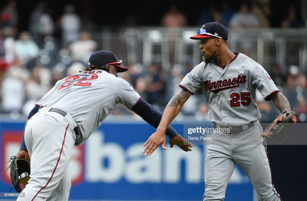 Miguel Sano #22 of the Minnesota Twins, left, and Byron Buxton #25 celebrate after beating the San Diego Padres 5-2 in a baseball game at PETCO Park on August 2, 2017 in San Diego, California.