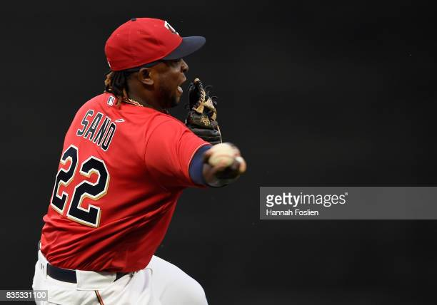 Miguel Sano of the Minnesota Twins makes a play to get out AJ Pollock of the Arizona Diamondbacks at first base during the first inning of the game...