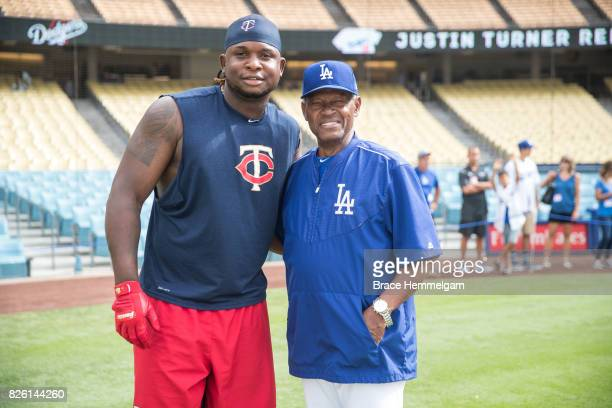 Miguel Sano of the Minnesota Twins poses for a photo with former Los Angeles Dodgers player Manny Mota prior to the game on July 24 2017 at Dodger...
