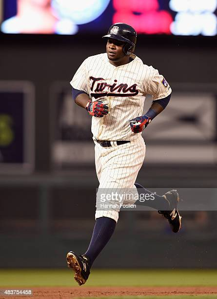 Miguel Sano of the Minnesota Twins rounds the bases after hitting a threerun home run against the Texas Rangers during the fourth inning of the game...