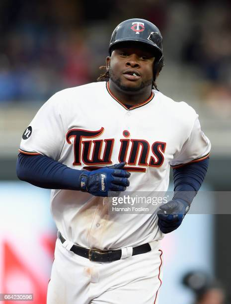 Miguel Sano of the Minnesota Twins rounds the bases after hitting a solo home run against the Kansas City Royals during the fourth inning of the...