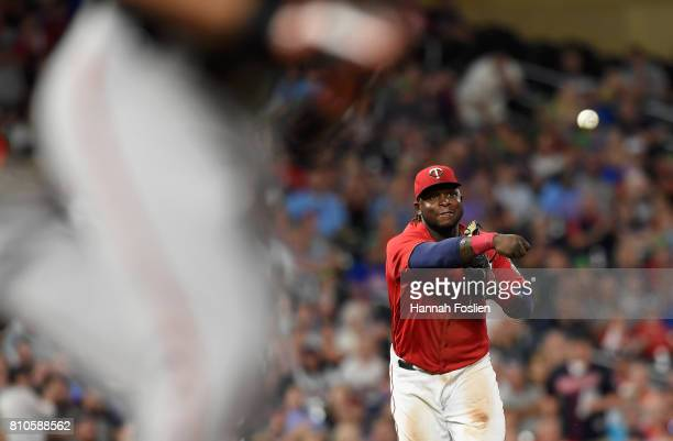 Miguel Sano of the Minnesota Twins throws to first base to get out Joey Rickard of the Baltimore Orioles during the eighth inning of the game on July...