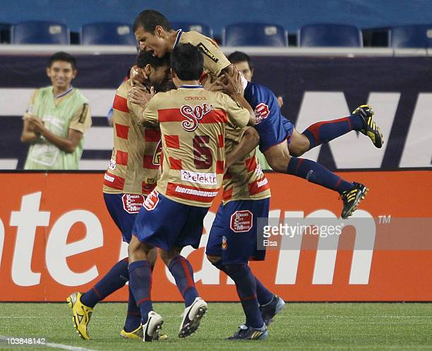 Miguel Sansores of Monarcas Morelia is congratulated by Hugo DroguetIsmael Pineda and Jaime Lozano after Sansores scored on a penalty kick in the...