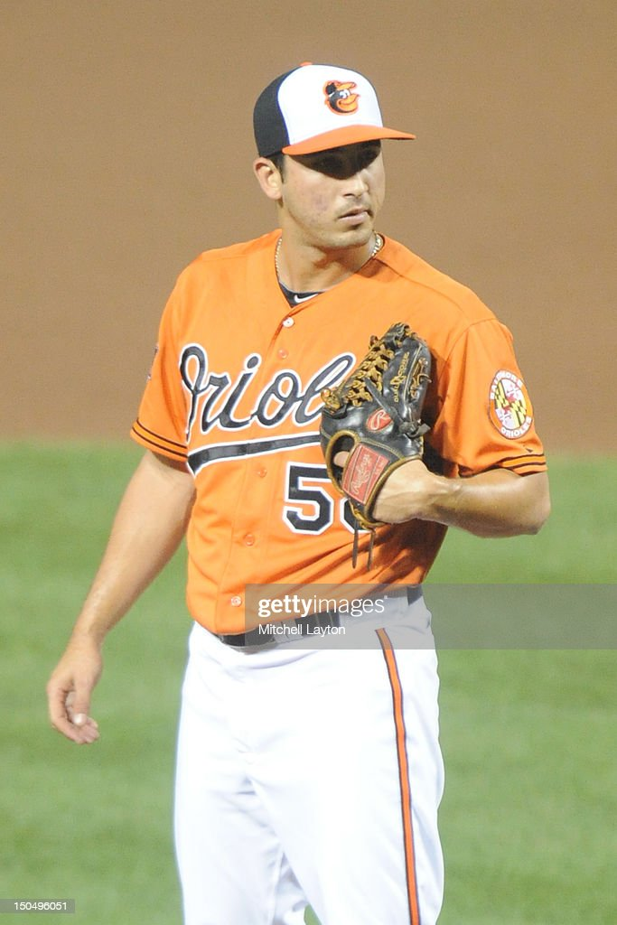 Miguel Socolovich #50 of the Baltimore Orioles pitches during a baseball game against the Kansas City Royals on August 11, 2012 at Oriole Park at Camden Yards in Baltimore, Maryland. The Royals won 7-3.
