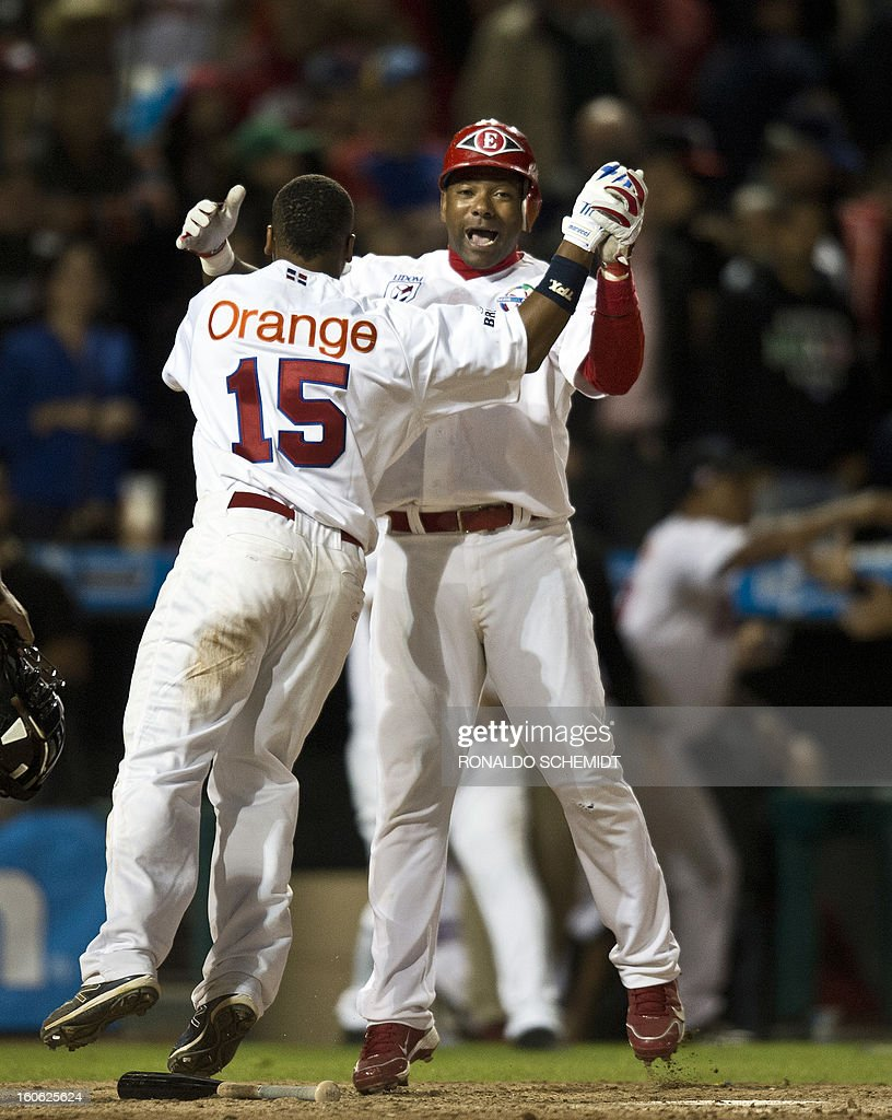 Miguel Tejada (R) and Jose Ramirez of Leones del Escogido from the Dominican Republic celebrates their victory against Yaquis de Obregon of Mexico during the 2013 Caribbean baseball series on February 3, 2013, in Hermosillo in the northern Mexican state of Sonora. AFP PHOTO / Ronaldo Schemidt