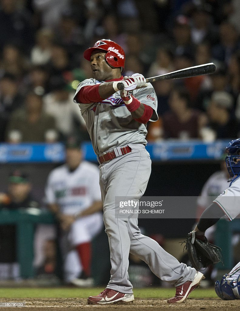 Miguel Tejada of Leones del Escogido of Dominican Republic, bats against Yaquis de Obregon of Mexico, during the 2013 Caribbean baseball series, on February 5, 2013, in Hermosillo, Sonora State, in the northern of Mexico. AFP PHOTO/Ronaldo Schemidt