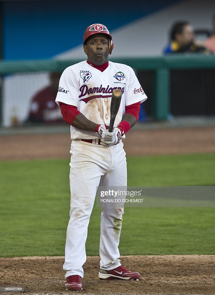 Miguel Tejada of Leones del Escogido of Dominican Republic, gestures during a match against Magallanes of Venezuela, in the Sonora Stadium, during the 2013 Baseball Caribbean Series, on February 1, 2013, in Hermosillo, Sonora State, northern Mexico. AFP PHOTO/Ronaldo Schemidt