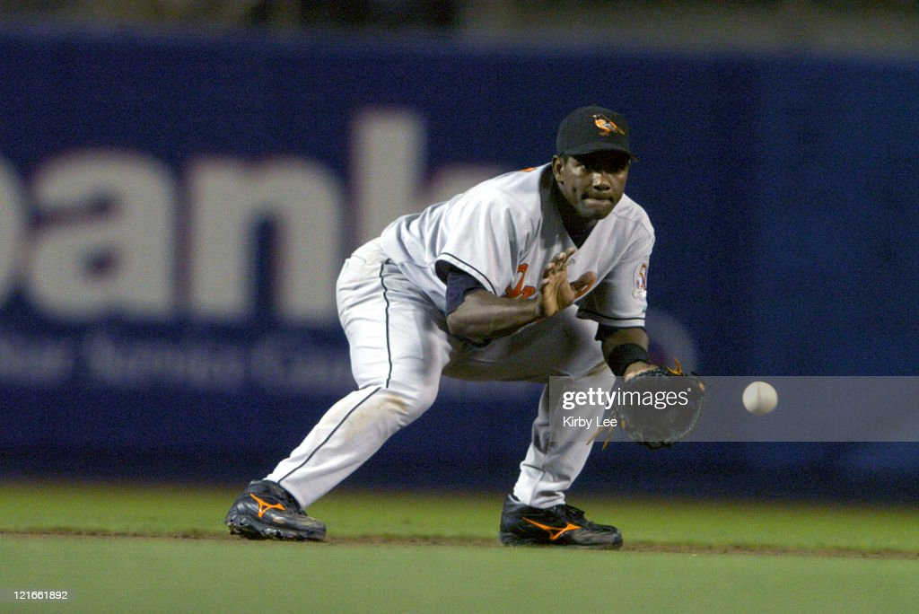 <a gi-track='captionPersonalityLinkClicked' href=/galleries/search?phrase=Miguel+Tejada&family=editorial&specificpeople=202227 ng-click='$event.stopPropagation()'>Miguel Tejada</a> of the Baltimore Orioles fields a ground ball by Paul Do Luca of the Los Angeles Dodgers to start a fifth-inning double play during 6-3 loss at Dodger Stadium on Wednesday, June 16, 2004.