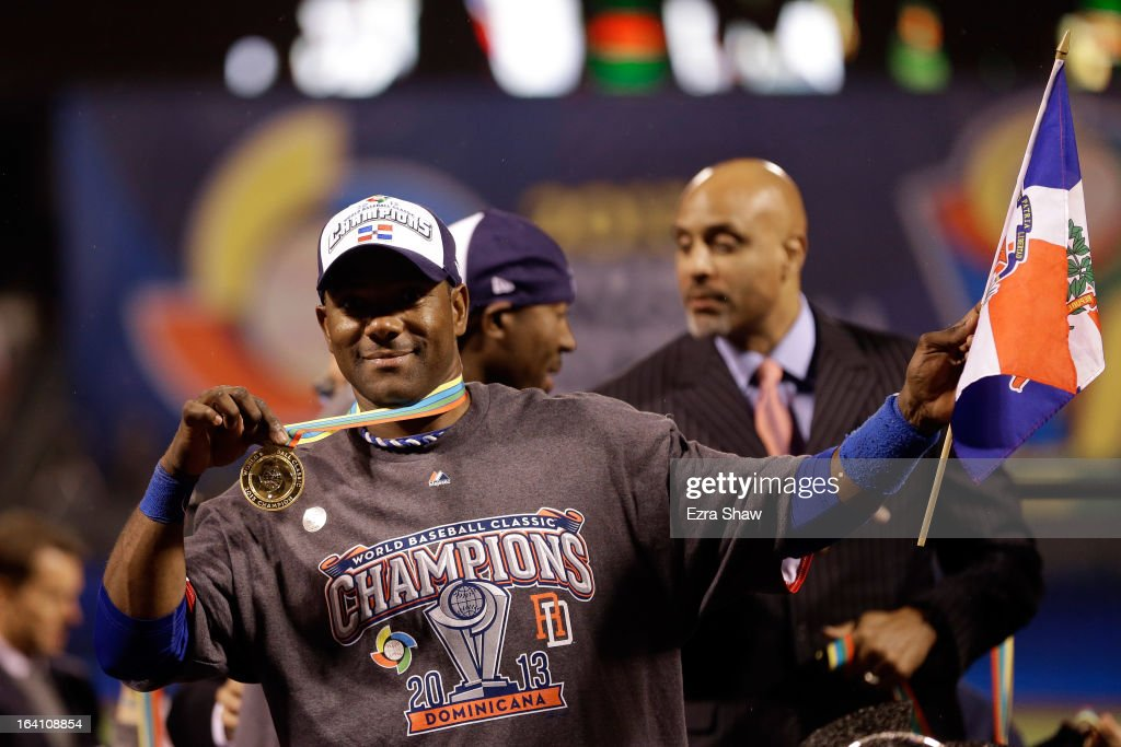 <a gi-track='captionPersonalityLinkClicked' href=/galleries/search?phrase=Miguel+Tejada&family=editorial&specificpeople=202227 ng-click='$event.stopPropagation()'>Miguel Tejada</a> #4 of the Dominican Republic celebrates after defeating Puerto Rico to win the Championship Round of the 2013 World Baseball Classic by a score of 3-0 at AT&T Park on March 19, 2013 in San Francisco, California.