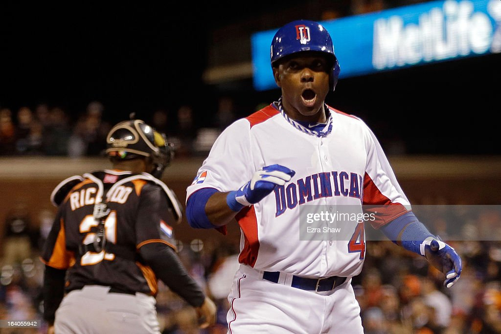 Miguel Tejada #4 of the Dominican Republic celebrates after scoring in the fifth inning against the Netherlands during the semifinal of the World Baseball Classic at AT&T Park on March 18, 2013 in San Francisco, California.