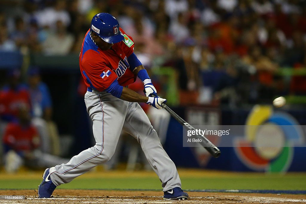 <a gi-track='captionPersonalityLinkClicked' href=/galleries/search?phrase=Miguel+Tejada&family=editorial&specificpeople=202227 ng-click='$event.stopPropagation()'>Miguel Tejada</a> #4 of the Dominican Republic gets a hit against Puerto Rico during the first round of the World Baseball Classic at Hiram Bithorn Stadium on March 10, 2013 in San Juan, Puerto Rico.