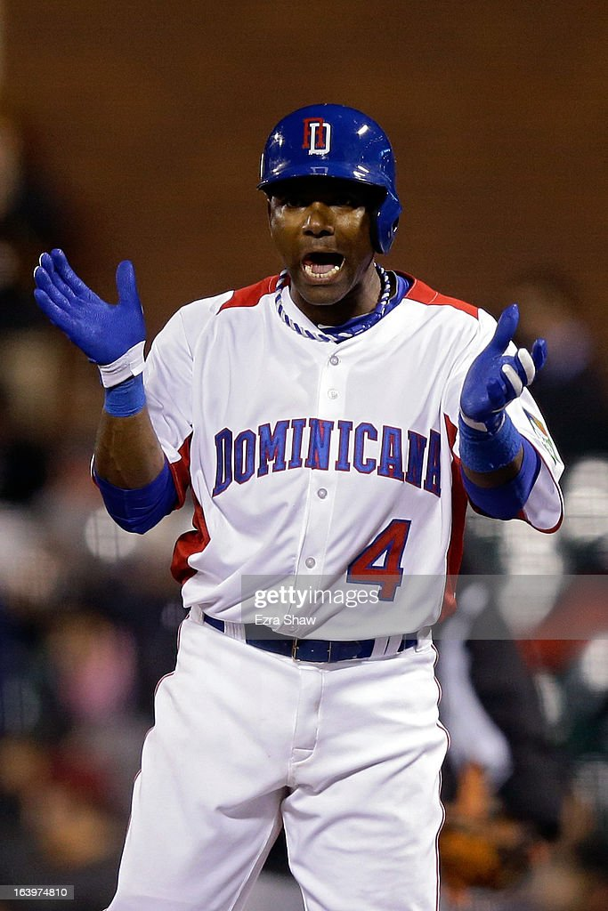 Miguel Tejada #4 of the Dominican Republic reacts after hitting a single in the fifth inning against the Netherlands during the semifinal of the World Baseball Classic at AT&T Park on March 18, 2013 in San Francisco, California.