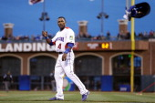 Miguel Tejada of the Dominican Republic reacts after striking out against the Netherlands during the semifinal of the World Baseball Classic at ATT...
