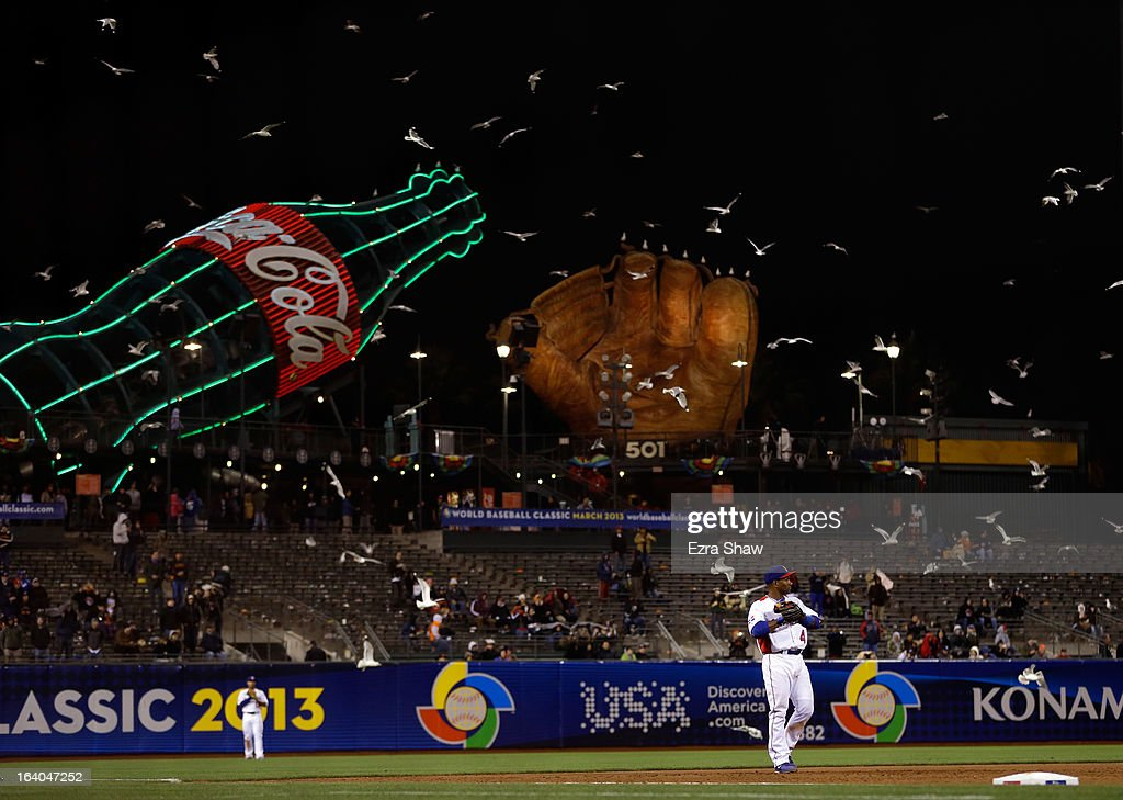 <a gi-track='captionPersonalityLinkClicked' href=/galleries/search?phrase=Miguel+Tejada&family=editorial&specificpeople=202227 ng-click='$event.stopPropagation()'>Miguel Tejada</a> #4 of the Dominican Republic stands at shortstops as seagulls circle overhead during the semifinal of the World Baseball Classic at AT&T Park on March 18, 2013 in San Francisco, California.
