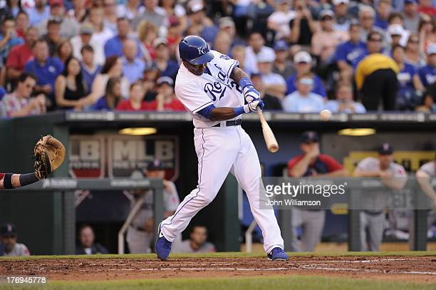 Miguel Tejada of the Kansas City Royals bats against the Boston Red Sox on August 10 2013 at Kauffman Stadium in Kansas City Missouri The Boston Red...
