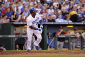 Miguel Tejada of the Kansas City Royals bats and runs to first base from the batter's box in the game against the Boston Red Sox on August 10 2013 at...