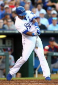 Miguel Tejada of the Kansas City Royals bats in a game against the Boston Red Sox at Kauffman Stadium on August 10 2013 in Kansas City Missouri The...