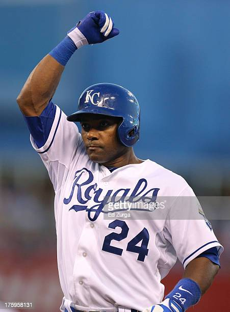 Miguel Tejada of the Kansas City Royals celebrates a RBI single in the fifth inning against the Boston Red Sox at Kauffman Stadium August 2013 in...