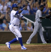 Miguel Tejada of the Kansas City Royals celebrates after scoring on a Alcides Escobar single in the fourth inning during a game against the Minnesota...