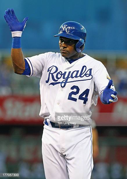 Miguel Tejada of the Kansas City Royals celebrates hitting a single in a game against the Boston Red Sox at Kauffman Stadium on August 10 2013 in...