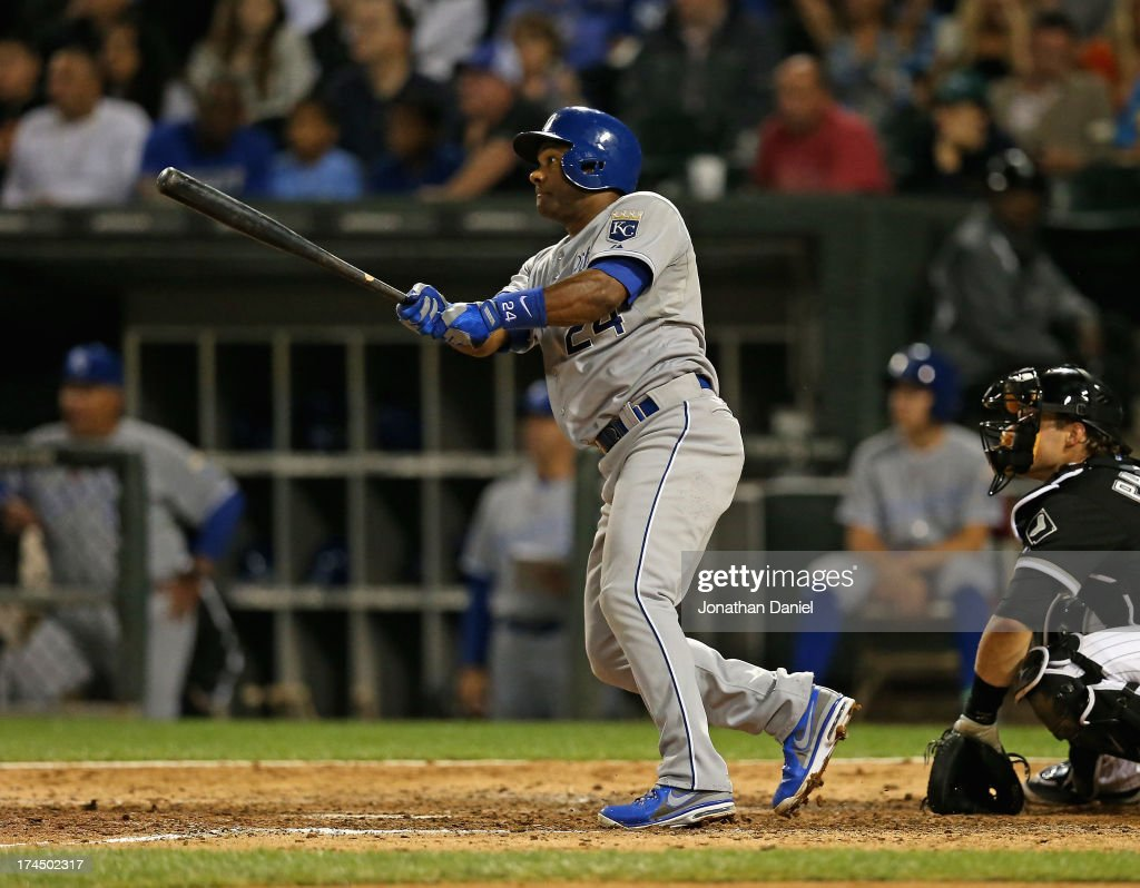 Miguel Tejada of the Kansas City Royals hits a runscoring sacrifice fly in the 7th inning against the Chicago White Sox at US Cellular Field on July...